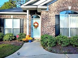 navy blue house black shutters yellow door color