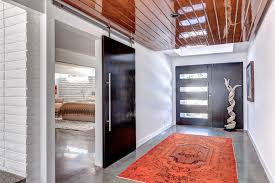 entry contemporary with barn door contemporary contemporary image by o homes inc