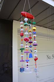Make a wind chime from recycled plastic lids! Full step by step tutorial  with printable