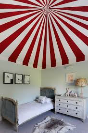 View in gallery Colorful circus tent inspired ceiling for the kids' bedroom  [Design: Turner Pocock]