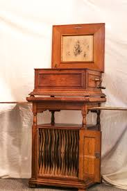 Buying and selling music boxes and parts. Bargain John S Antiques Antique Oak Regina Music Box With Double Combs Several Discs Oak Storage Stand Bargain John S Antiques