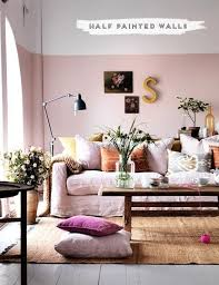 living room with half painted pink wall