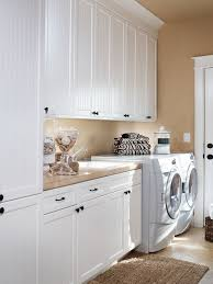 laundry furniture. traditional laundry room idea in portland with white cabinets furniture