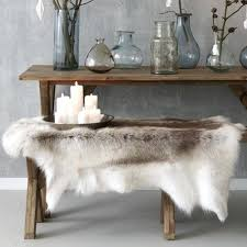 faux animal skin rugs reindeer throw on bench ikea faux animal skin rugs