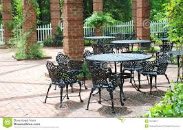 rot iron furniture. Wrought Iron Furniture In Airy Courtyard Rot