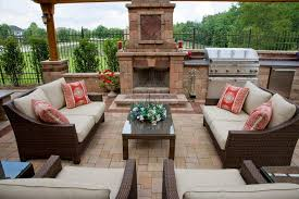 olde greenwich cobble patio with fireplace and bbq grill island