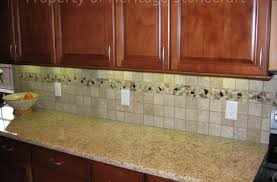 giallo ornamental granite images best furniture models veneziano countertops white cabinets