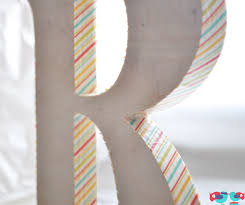 Use washi tape to decorate a plain wood letter @ thelovenerds