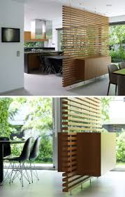 This slatted wooden room divider has a built-in cabinet. | TODAYS ...