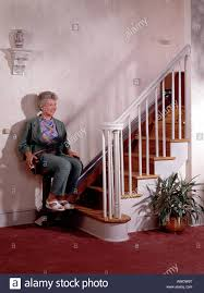 home chair elevator. stock photo - grandmother using in home chair lift elevator handicap senior citizen copy space f