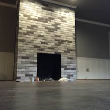 Gray Brick Fireplace My After Fireplace Project Painted Each Brick With Leftover Wall