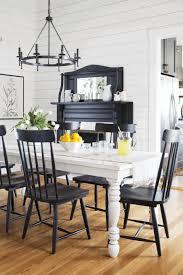 round chandelier over rectangular table whale bath rug buffet genuine