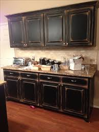 Black cabinets with faux distressing. Used 3 different colors of flat paint  to create this