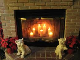 twin small tiger sculptures and brick wall fireplace with romantic candles inside