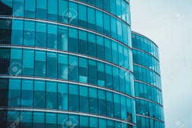 office facades. Exterior Facades Of Two Curved Commercial Buildings Or Office Blocks With Glass Walls Standing Side By