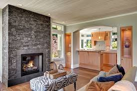 stacked stone fireplace dining