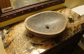 antique brown marble top with brown varnished wooden vanity and solid granite countertop