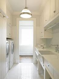 White Laundry Room Lighting Via Sarah Sarna.