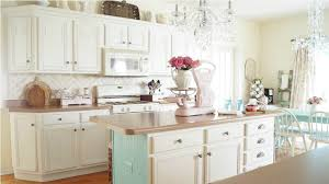classic kitchen ideas with white chalk paint cabinet using butcher block island and crystal chandelier