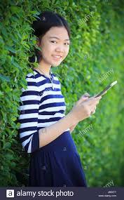 Asian teen in green