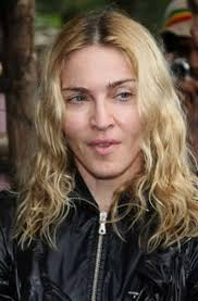 madonna was spotted looking like she just stepped into a splash of rain she was seen sporting a black leather waterproof jacket and her signature beach