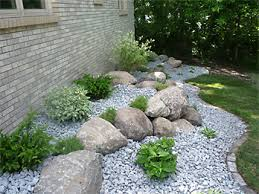 Boulders and shrubs in rock garden