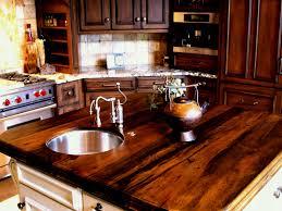 white kitchen island with wooden countertop dark tone cabinets granite backsplash tile single wall oven slide