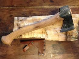 carved axe handle. image carved axe handle a