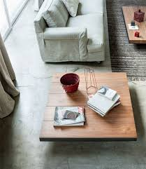 brass plated steel marble effect ceramics and smoked glass the table offers finesse style and charm for any modern living room arrangement