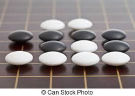 Game With Stones And Wooden Board Black and white go game stones and wooden bowls on wood picture 81