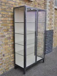 Metal glass cabinet Wayfair Vintage Display Cabinet Grand Idea For Shoes And Bags Pinterest Vintage Metal And Glass Cabinet By Livypalm Furnish Cabinet