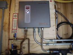 tankless water heater mounted to utility room wall