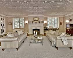 Huge traditional living room idea in New York with beige walls and a  standard fireplace