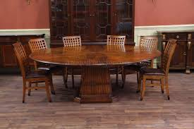 Solid Walnut Round Dining Table With Self Storing Leaves - Walnut dining room furniture