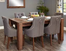 trendy round table for 8 25 seater dining with rough tile flooring and chandelier over regard to room your property