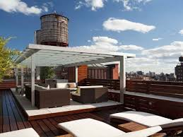 splendid rooftop decor with white pergola and wicker furnishings