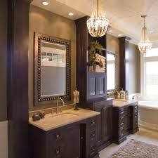 bathroom double vanity with center tower. custom cabinetry; bathroom cabinets; cabinetry in bath; luxurious; elegant; dark wood double vanity with center tower t