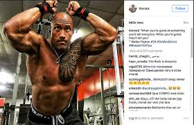 the rock shows off his biceps triceps workout arms