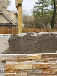 attach stacked stone to outdoor fireplace