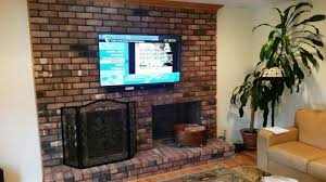 mounting tv above brick fireplace luxury flat screen over