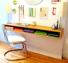 Wooden floating desk by IKEA with single shelf for books and documents a  chair with white