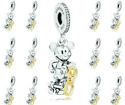 the mickey mouse figure is crafted in del from pandora s signature metal sterling silver and with the anniversary number 90 next to him made from 14k
