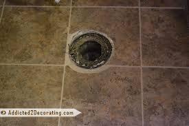 bathroom makeover installing self adhesive vinyl tile easy to cut around corners