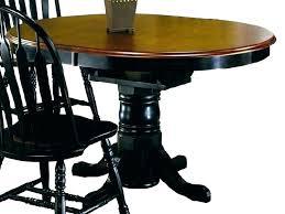 black pedestal table mad round