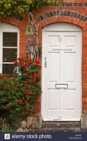 white front doorWhite front door of a red brick house known as Teachers Cottge in