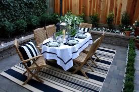 design ideas a striped rug creates an elegant outdoor dining area