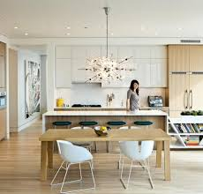 love our bubbles glass chandelier shown in this modern kitchen in this setting the chandelier helps to soften the dramatic lines of the furniture and