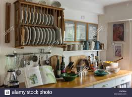 Wooden Plate Racks For Kitchens Rustic Style Kitchen With Wooden Plate Rack Assorted Jugs And