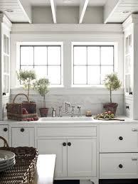 white cottage kitchens. White + Marble Kitchen {via Traditional Home}...love The Upper Built-ins Flanking Sink Cottage Kitchens E