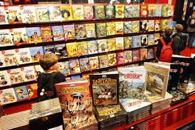 young visitors browse hard cover cartoon books at the annual paris book fair march 14